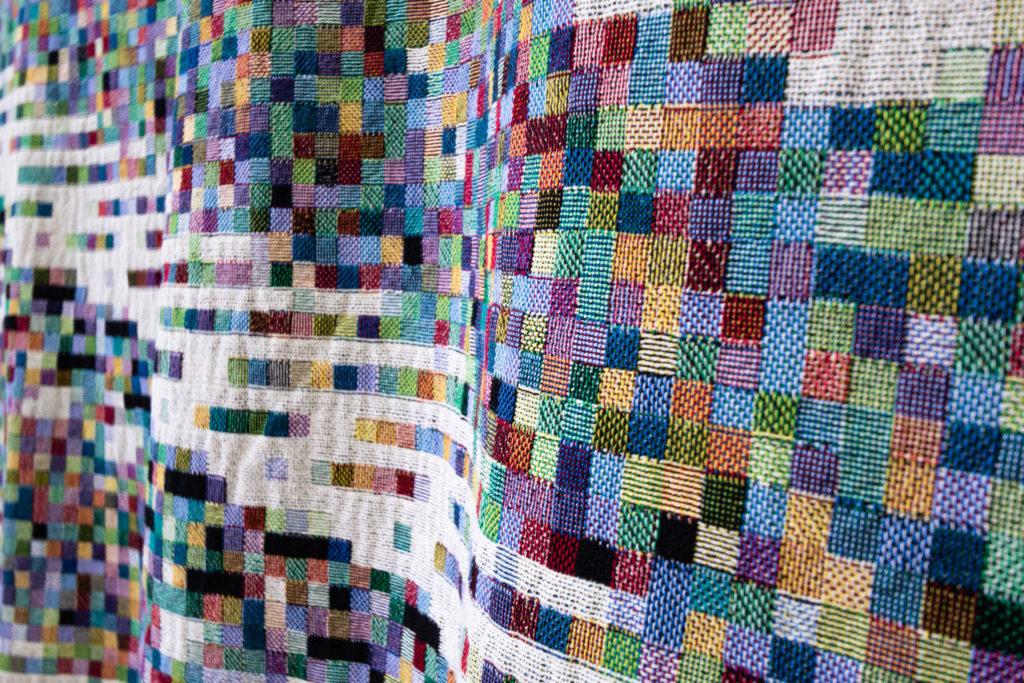 an artist is making blankets out of blockchain data and they re